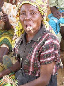 Lady chewing baobab fibers