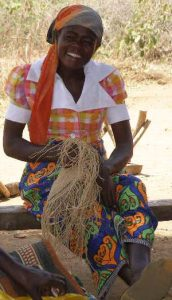 Lady weaving baobab fibers
