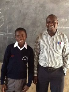 Otieno with Headmaster